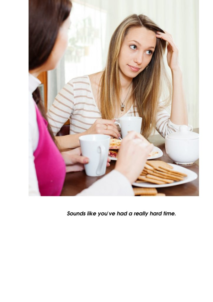 Two female friends having coffee. One looks like she is sharing a problem.